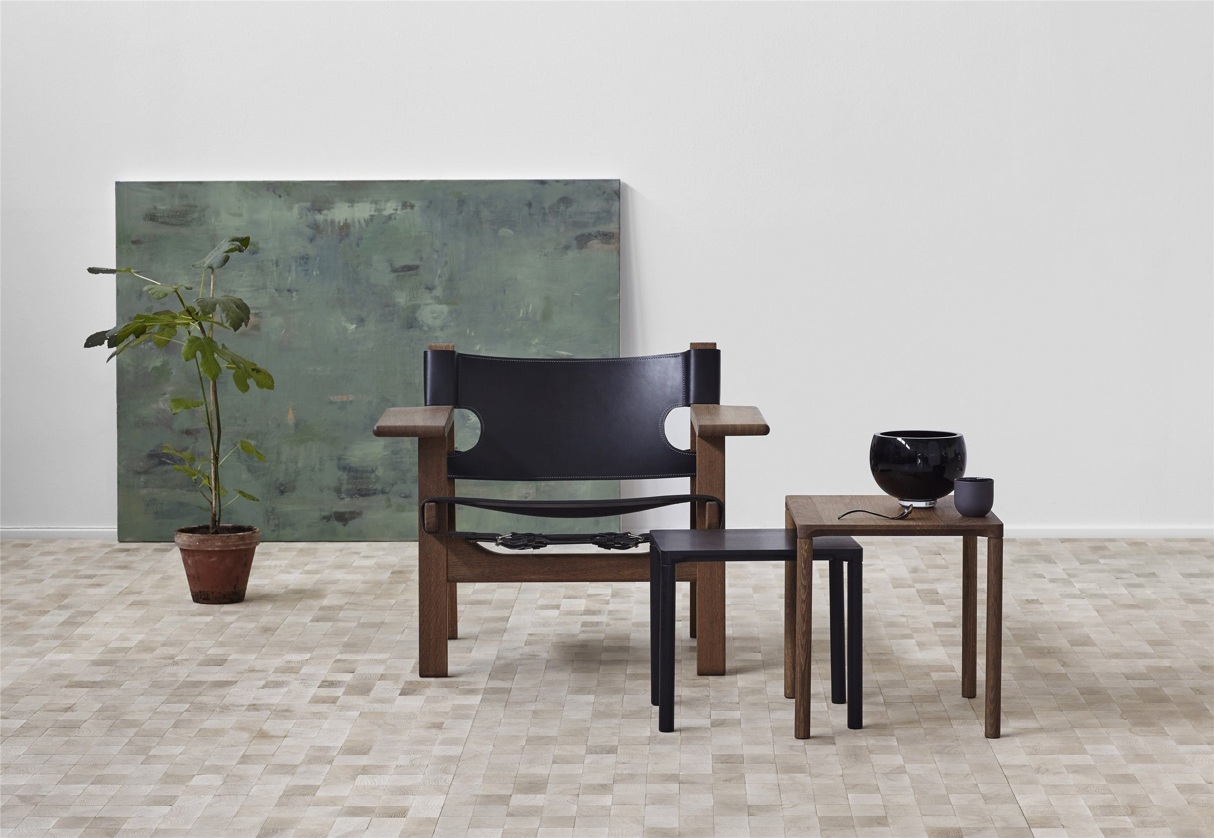 With the Spanish Chair Mogensen expanded upon his work with solid oak and saddle leather. The chair was launched in 1958 as part of an innovative living space exhibition, in which all tables were removed from the floor to create an open living space.