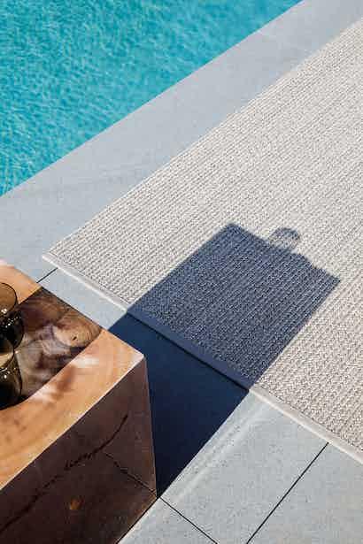 Limited edition rugs poolside rug pebblestone insitu haute living