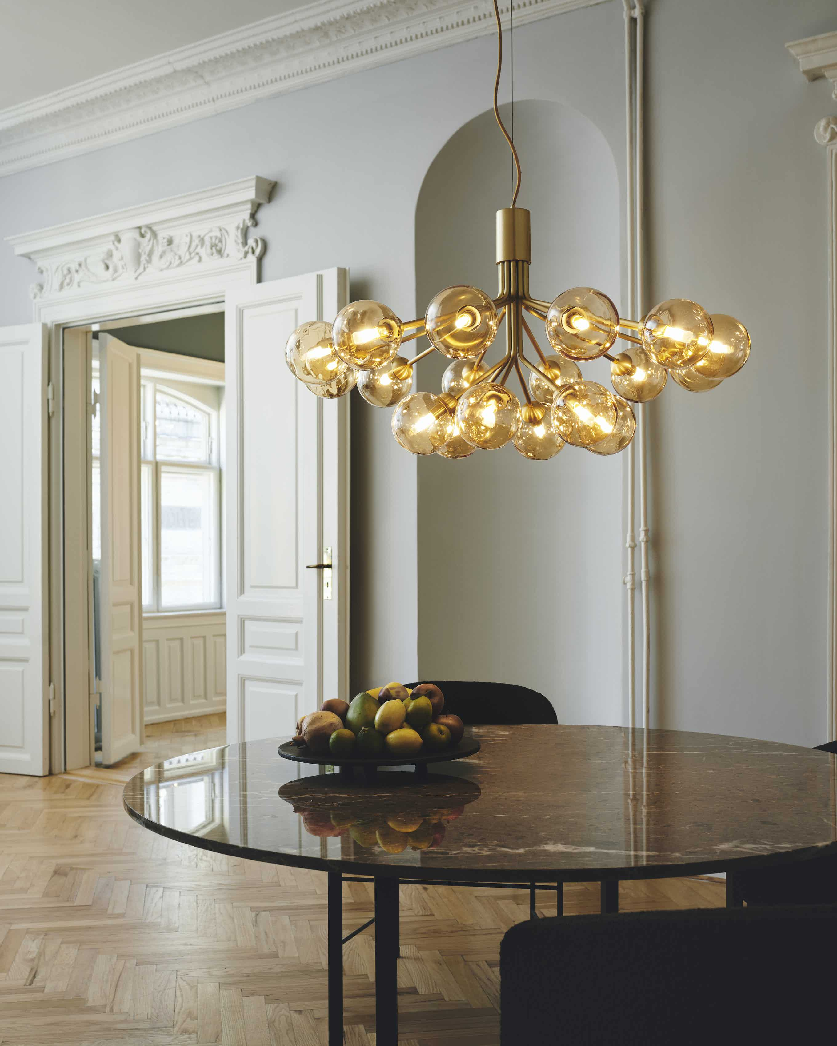 With inspiration from flowers, Sofie Refer designed the Apiales 18 chandelier. From a specially-produced canopy, the arms unfold like flower stalks from which light is spread with grace.