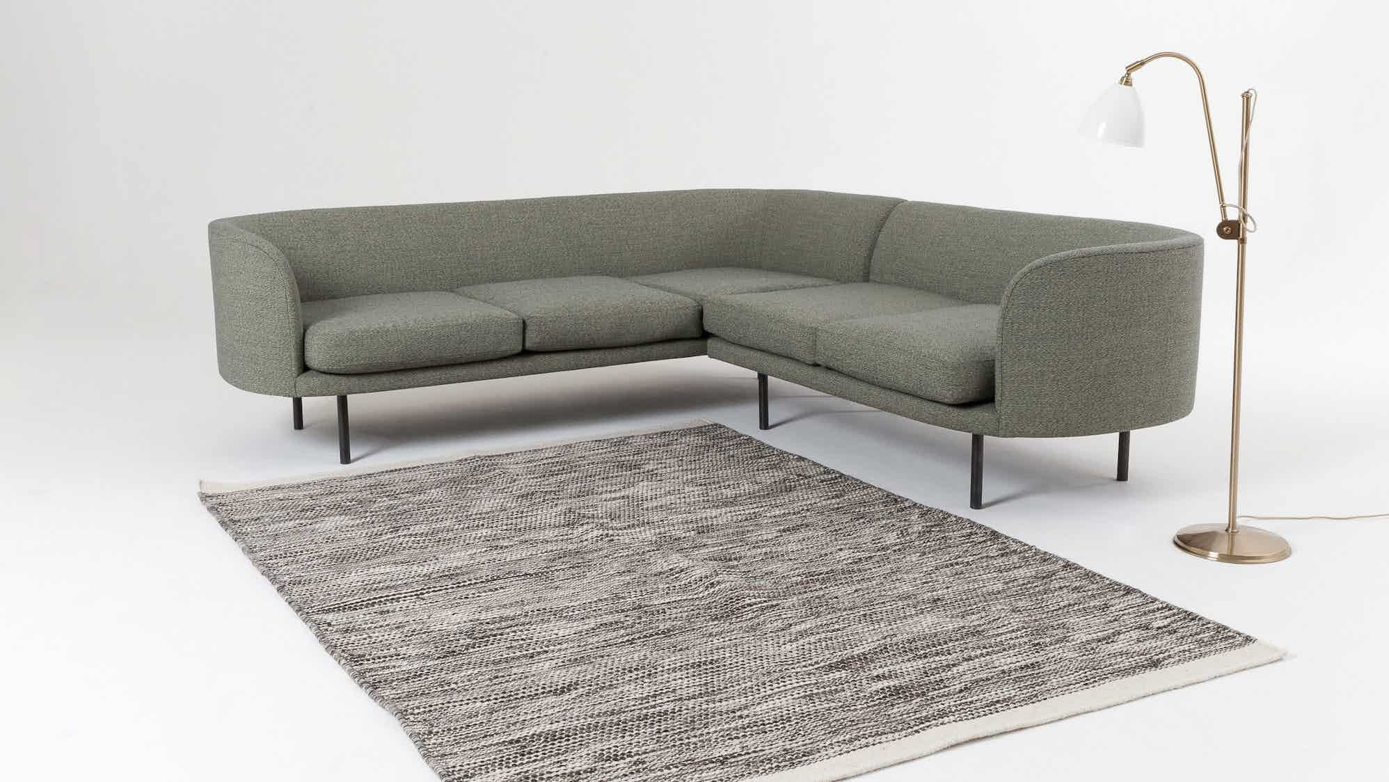 Scp continous sectional sofa green rug haute living