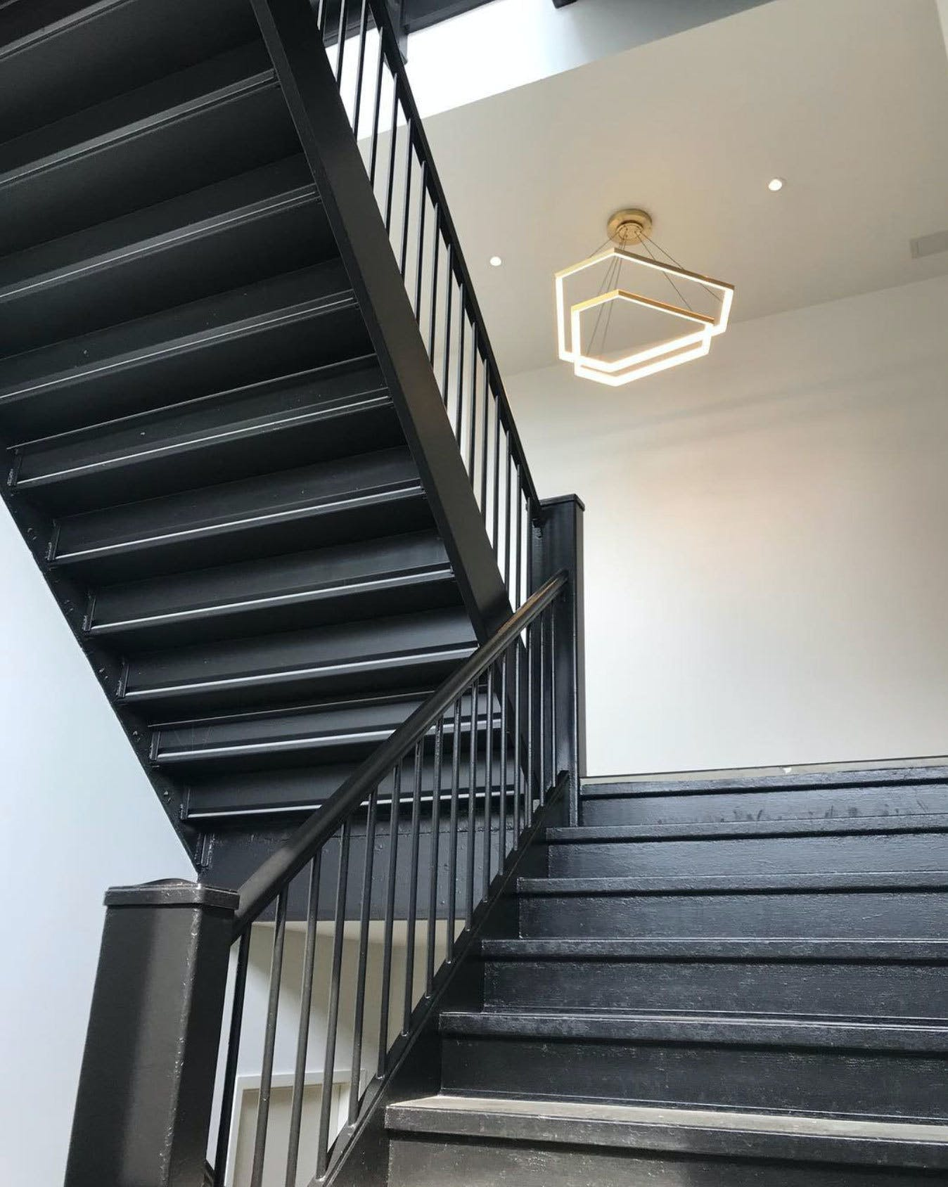 Studio-endo-ditri-cascade-dxc43-hanging-light-stairwell-insitu-haute-living