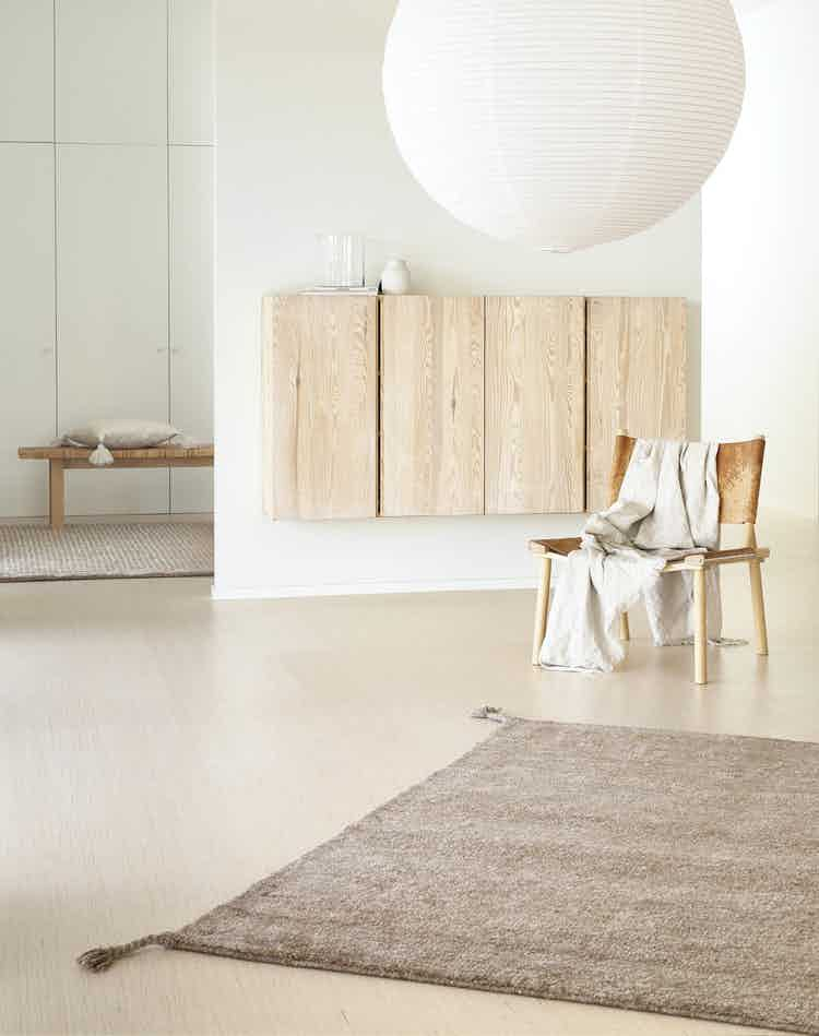 Woodnotes uni hand knotted wool carpet camel insitu haute living