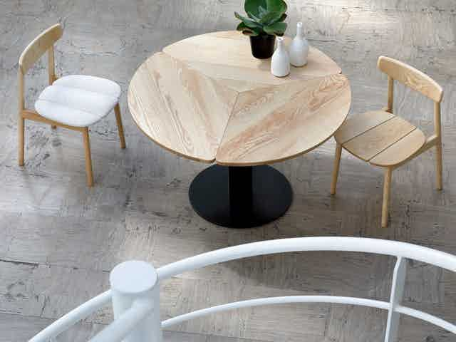 Coedition klee dining table insitu aerial haute living