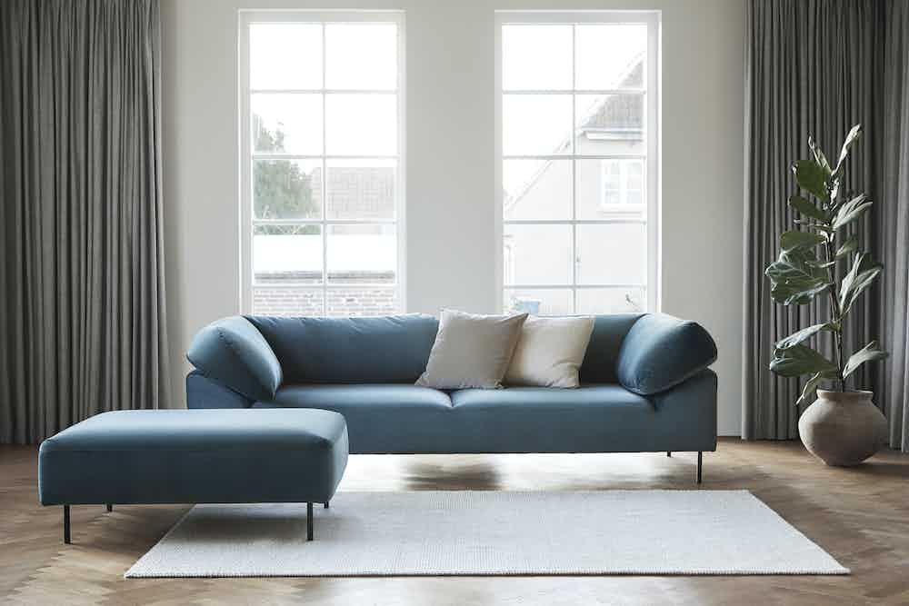 Woud furniture collar modular sofa teal pouf insitu haute living