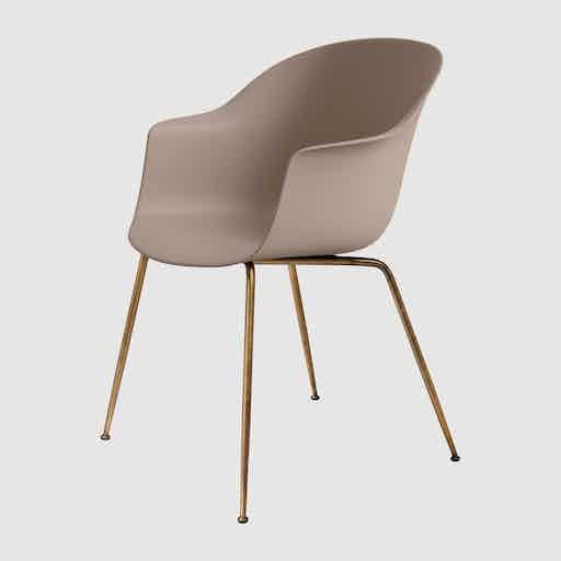 Gubi beige gold bat dining chair haute living
