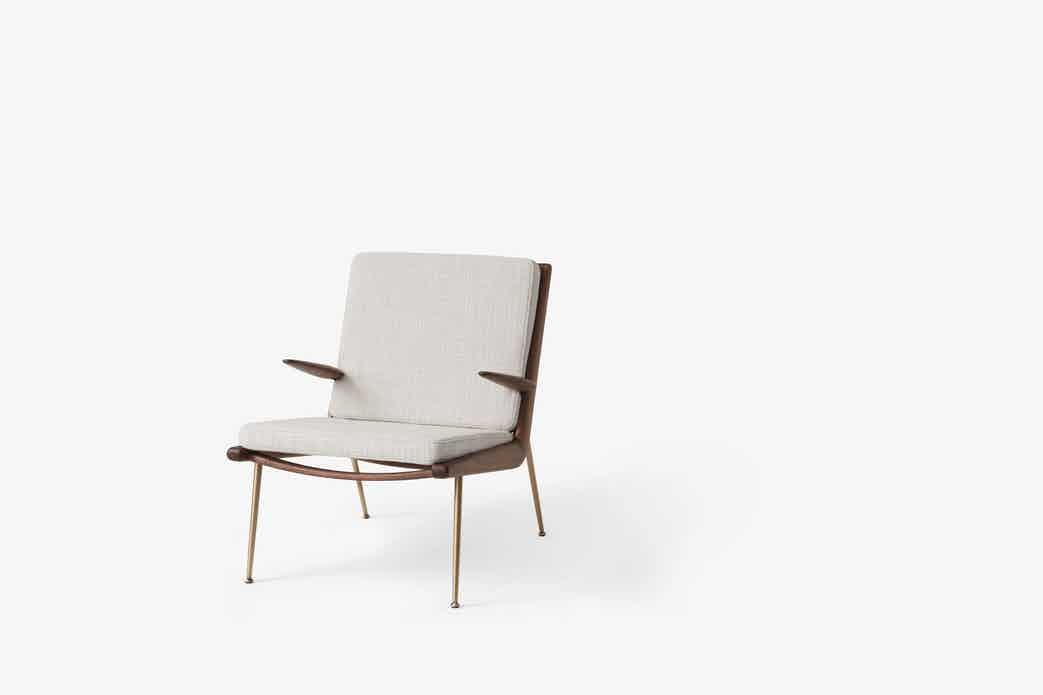 Andtradition boomerang lounge chair hm2 walnut cream haute living