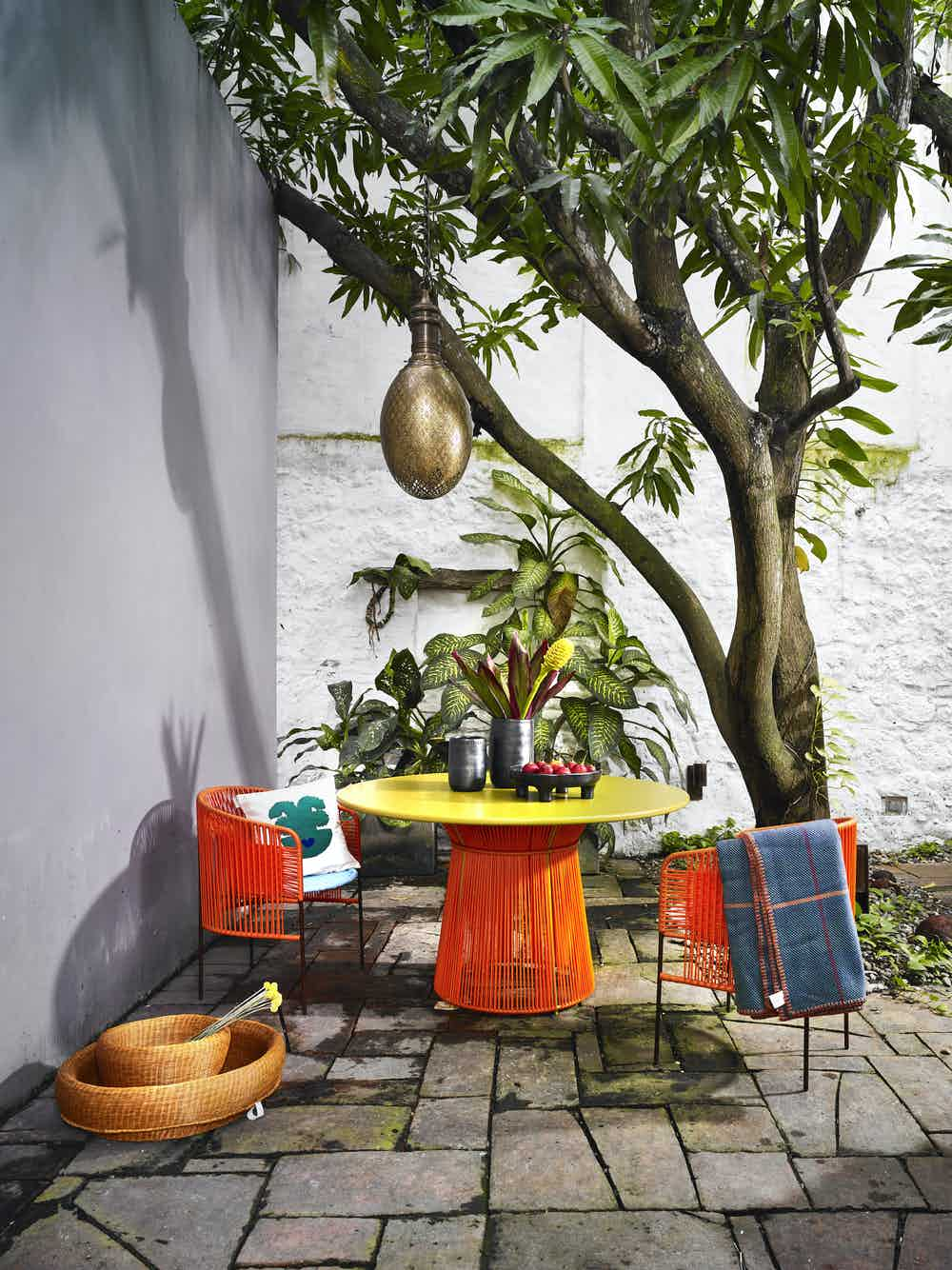 Ames furniture design caribe dining table orange insitu haute living