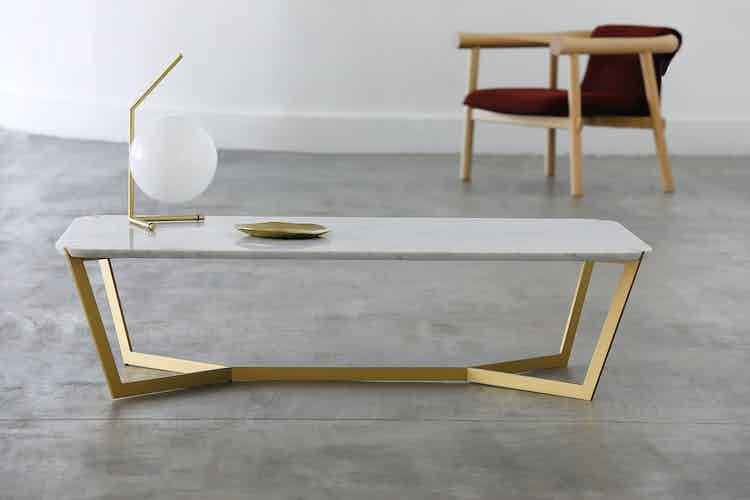 Coedition star coffee table gold insitu haute living