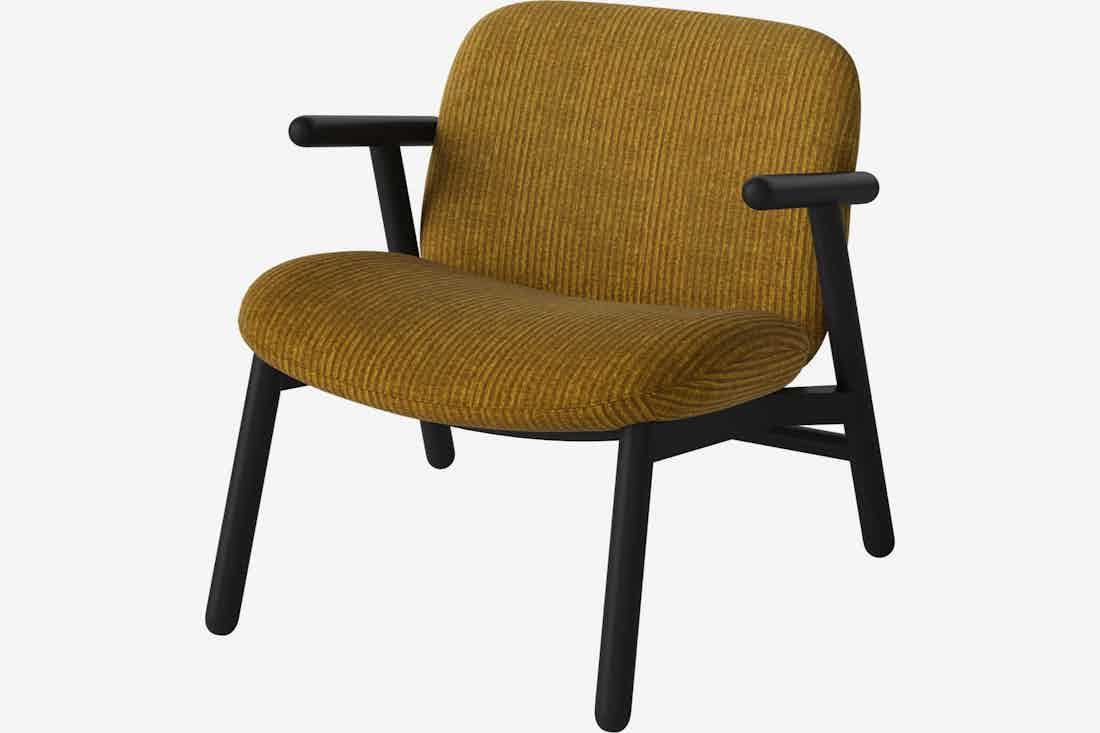 Bolia cosh armchair yellow haute living
