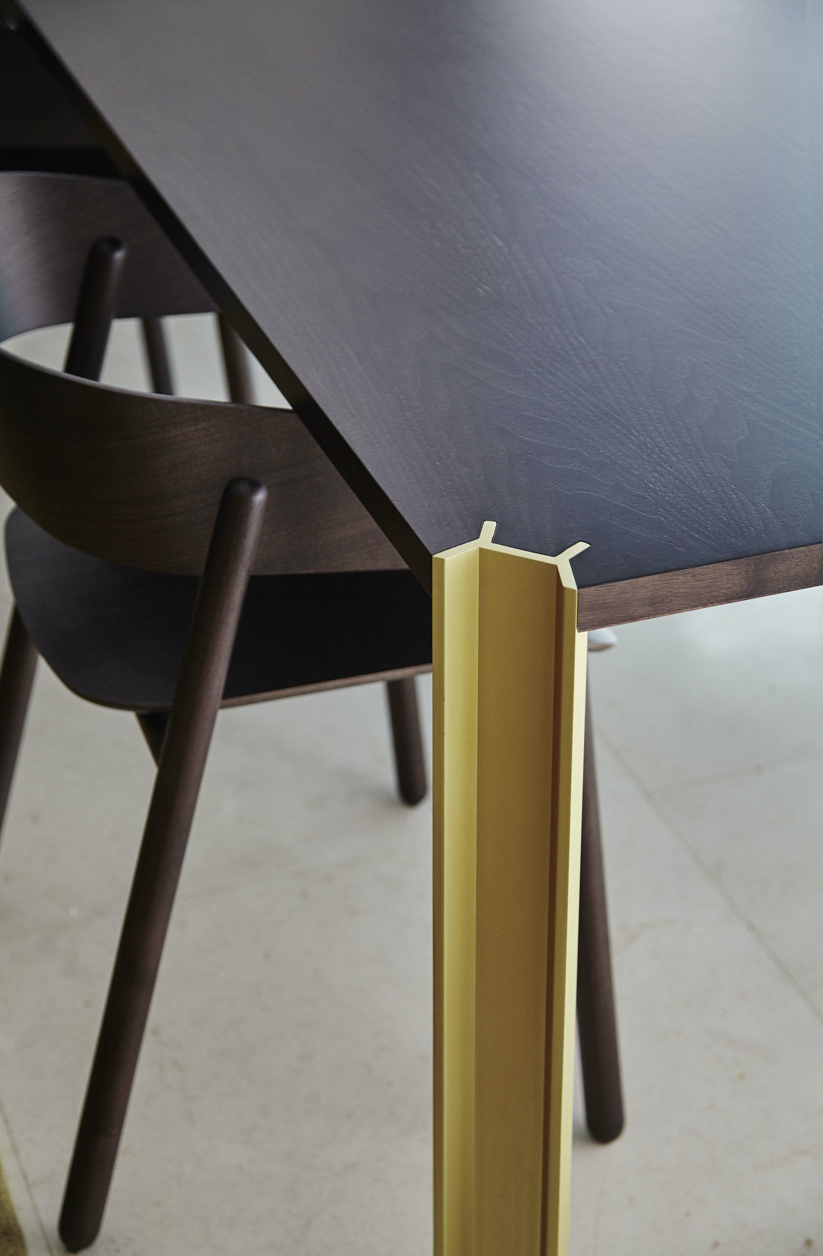 Punt Furniture Crossing Insitu Black Leg Detail Gold Haute Living