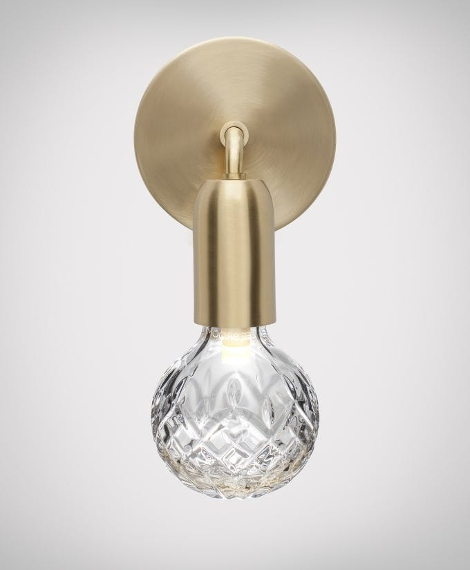 Croppedimage680825 Clear Crystal Bulb Brushed Brass Wall Light Facing Down Studio