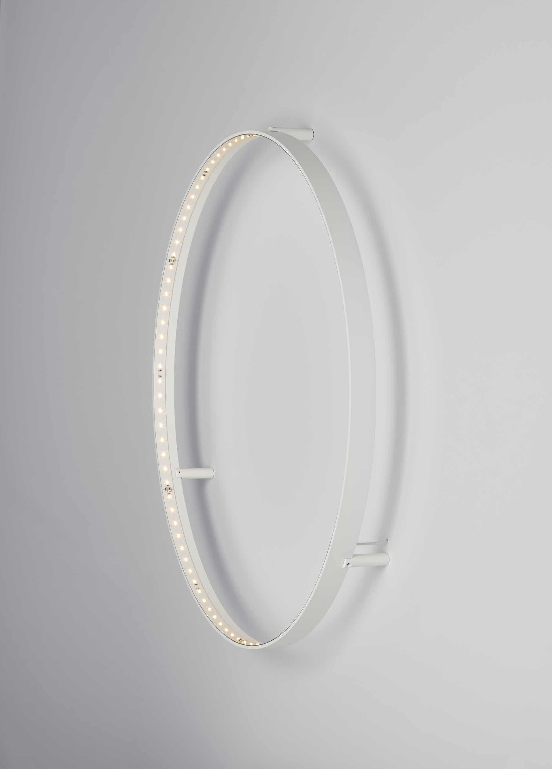 Le-deun-luminaires-curve-60-wall-lamp-white-profile-on-haute-living