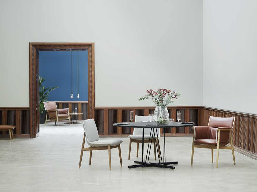 Carl-hansen-black-e020-embrace-table-insitu-haute-living