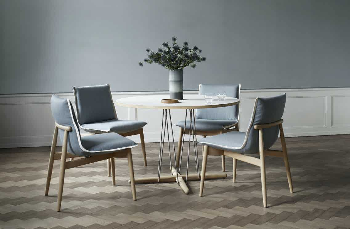Embrace-table-chairs-by-carl-hansen-haute-living