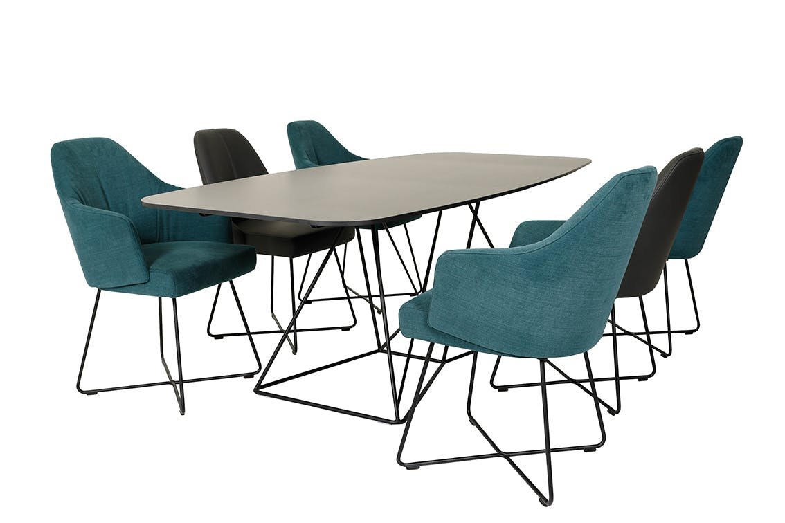 Jab Anstoetz Flow Dining Table Angle With Chairs Haute Living