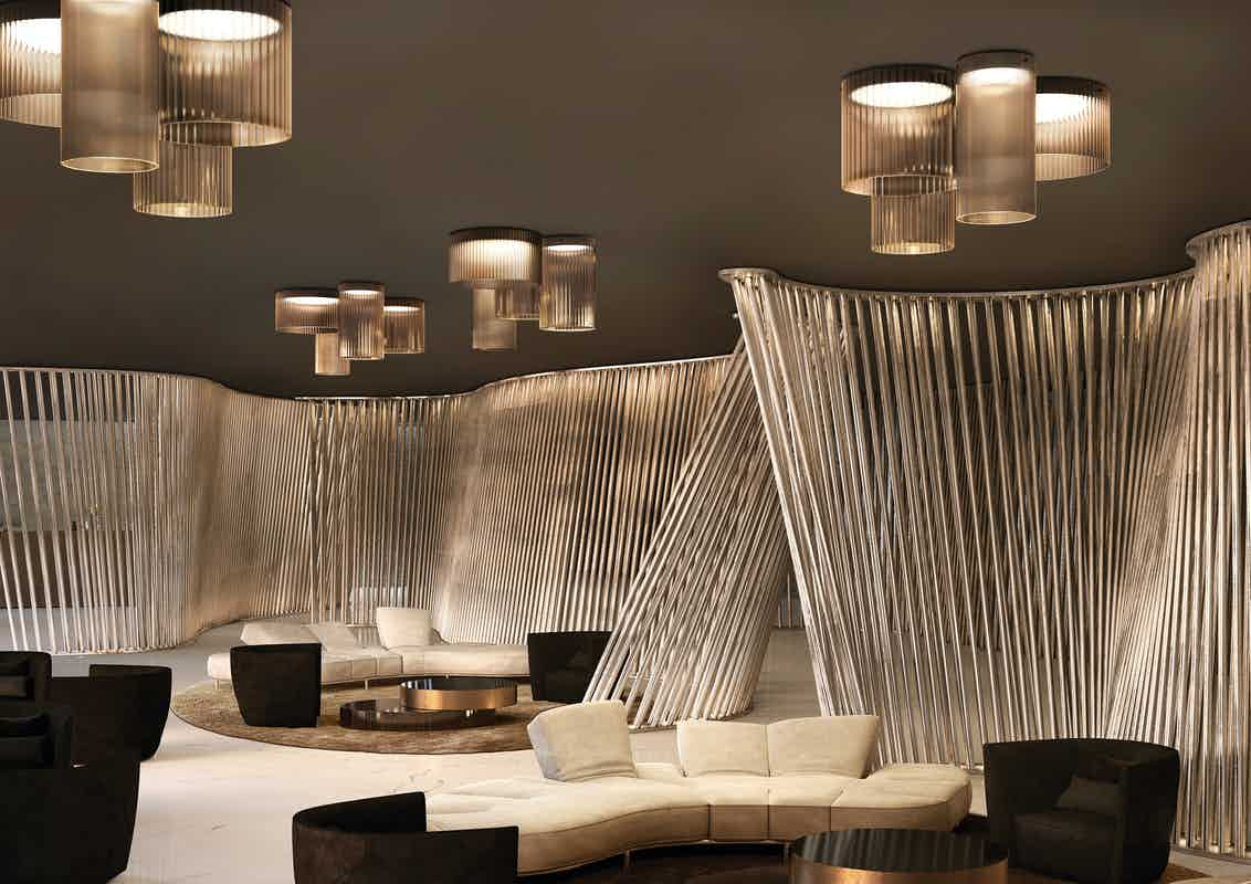 Kundalini lighting giass ceiling light insitu haute living