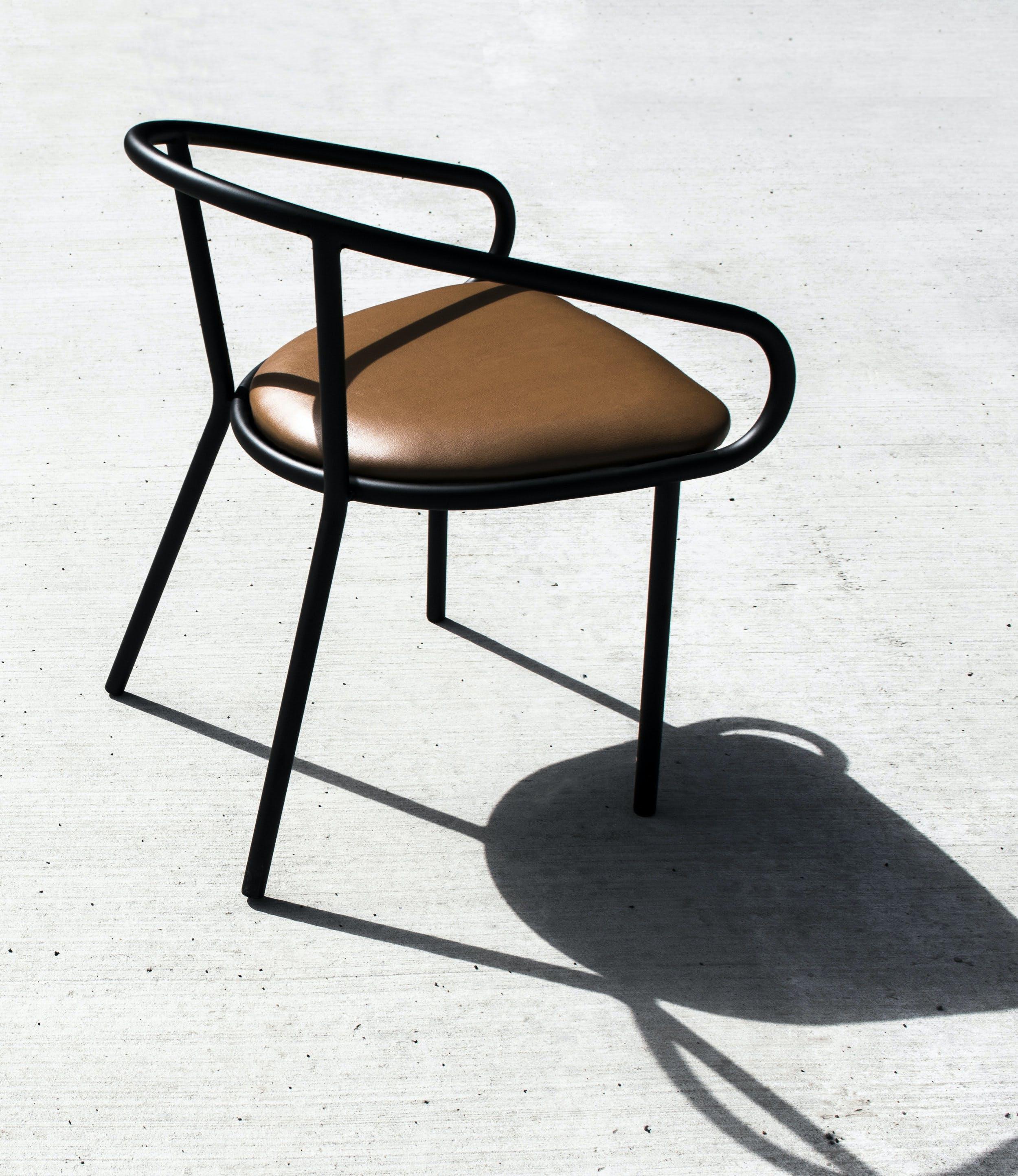 Division 12 Wedge Arm Chair Rear Haute Living
