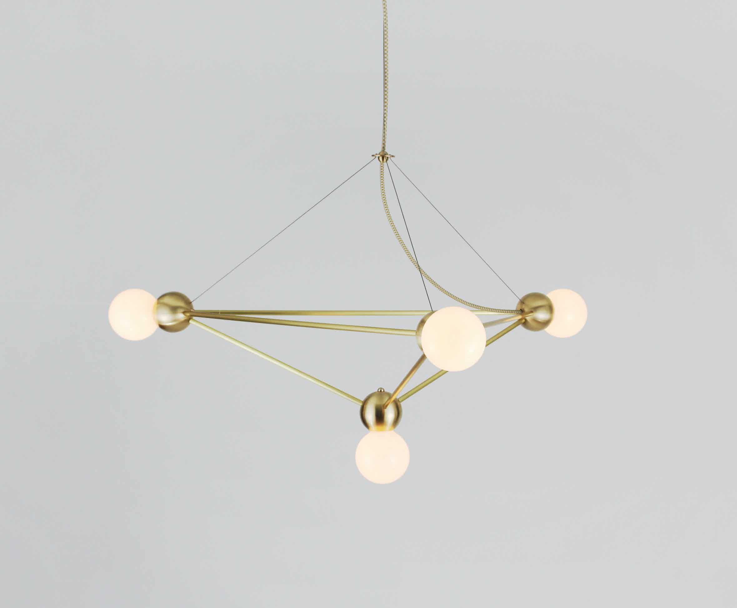 Rosie li lina 04 light pyramid lg chandelier brass angle haute living