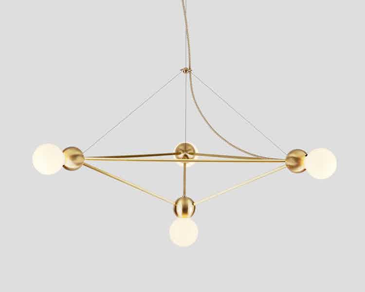 Rosie li lina 04 light pyramid lg chandelier brass haute living