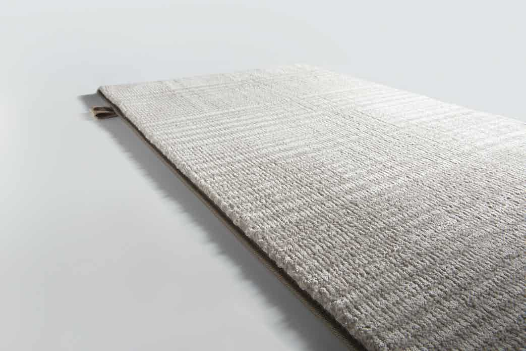 Limited Edition Rugs Magnetic Rug Tuffet Haute Living
