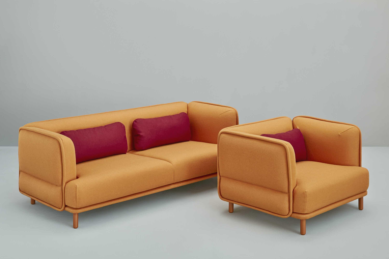 Missana-hug-sofa-with-chair-insitu-haute-living