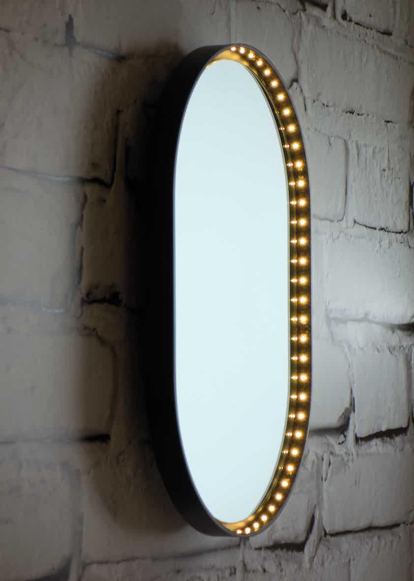 Le-deun-luminaires-vanity-oval-wall-mirror-brick-wall-haute-living