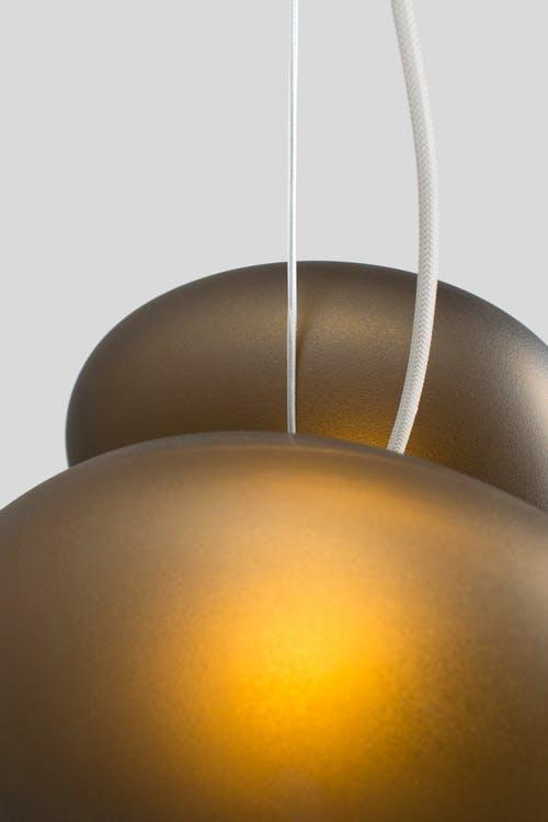 Andlight-pebble-pendant-citrine-detail-haute-living