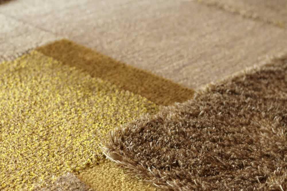 Carpet-sign-Salinas-de-Maras-ash-gold-rug-detail-haute-living