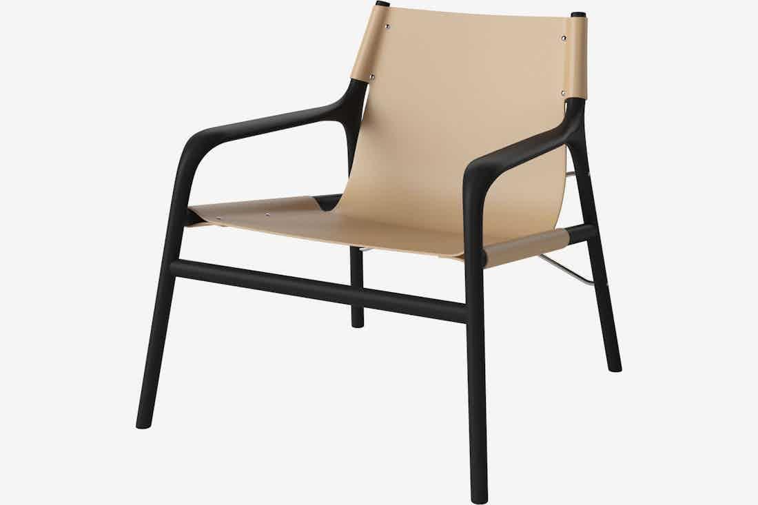 Bolia soul lounge chair black tan haute living