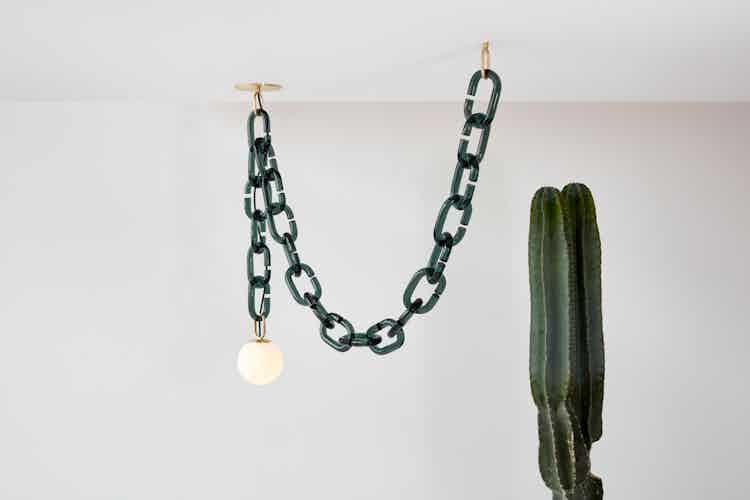 Trueing design cerine swagged pendant insitu haute living