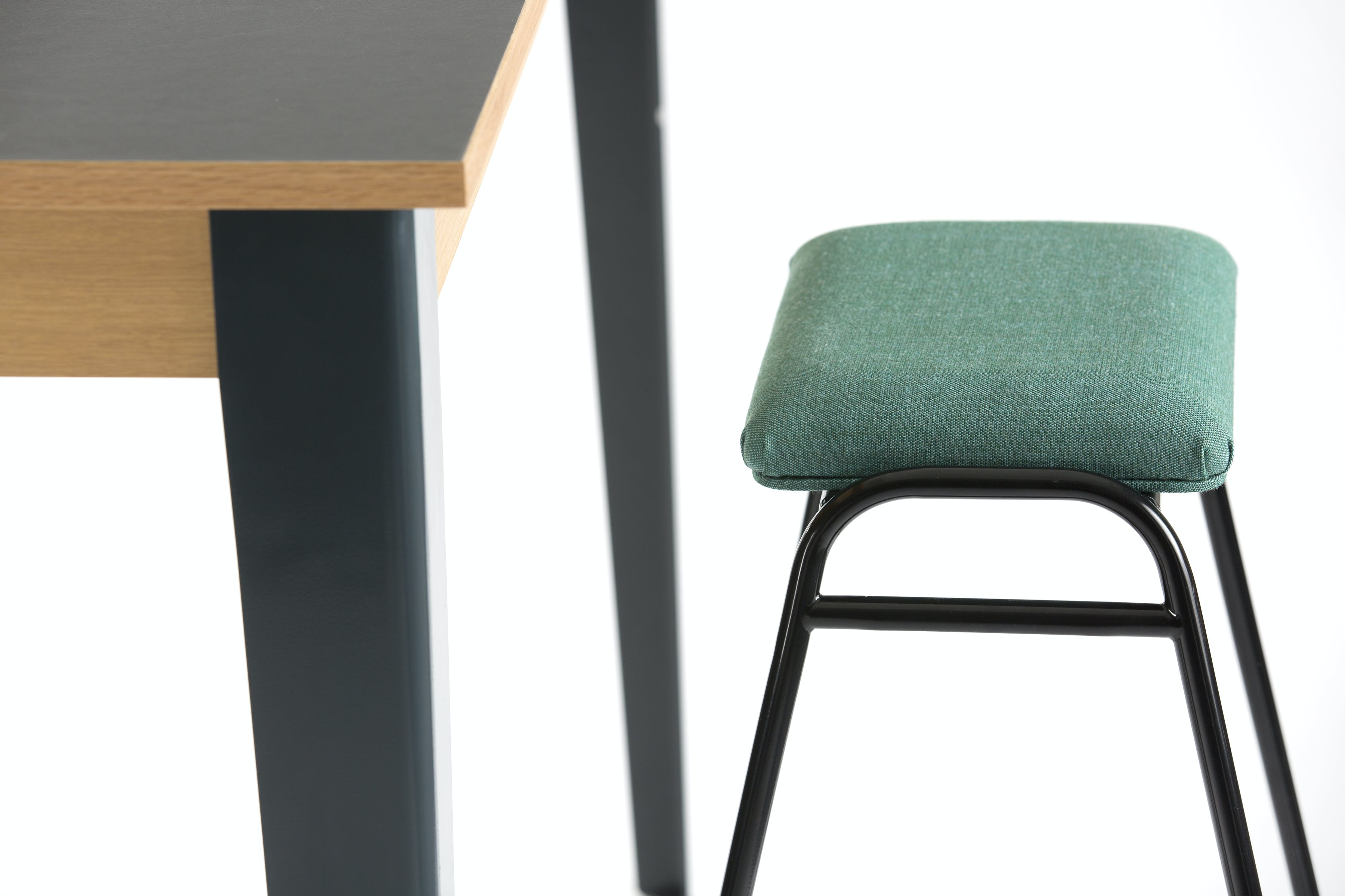 Deadgood-working-girl-soft-black-stool-green-haute-living