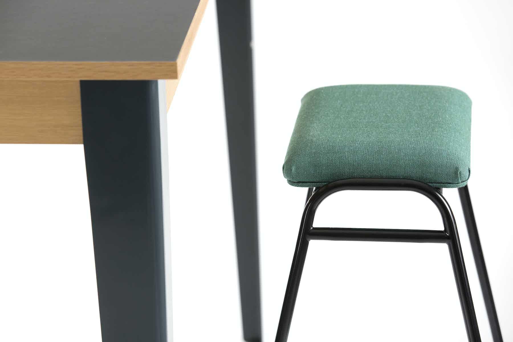 Deadgood-working-girl-soft-black-stool-green-haute-living